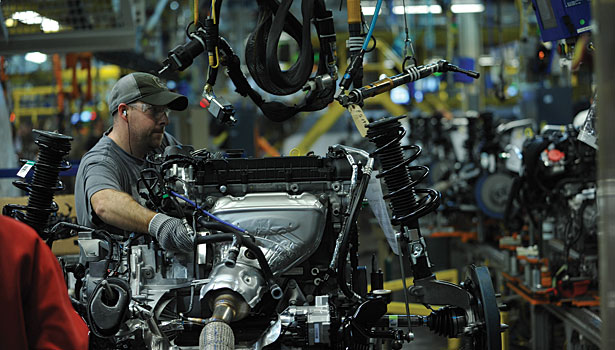 A Ford motor worker on the factory assembly line